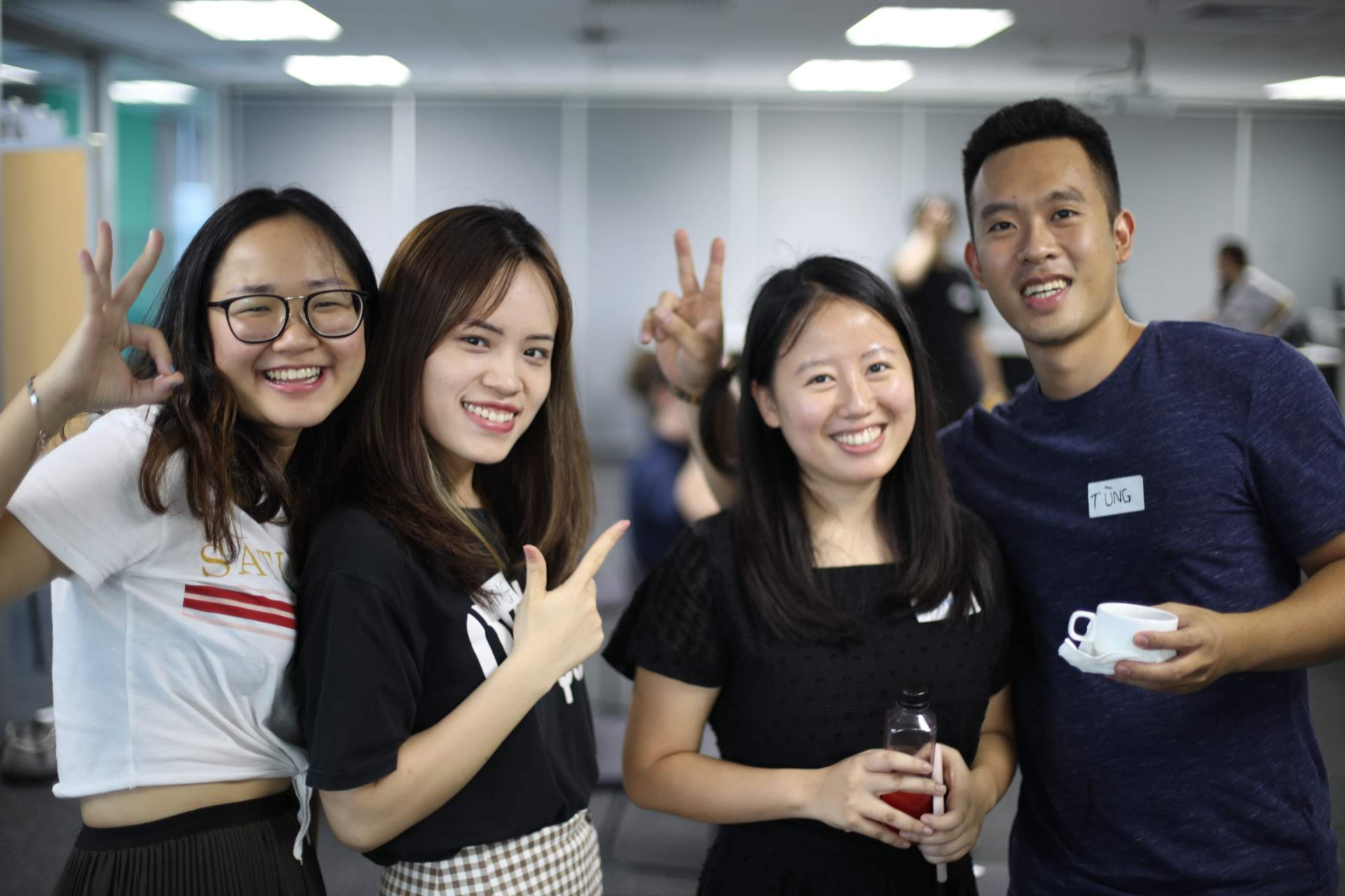 four workshop attendees posing and smiling