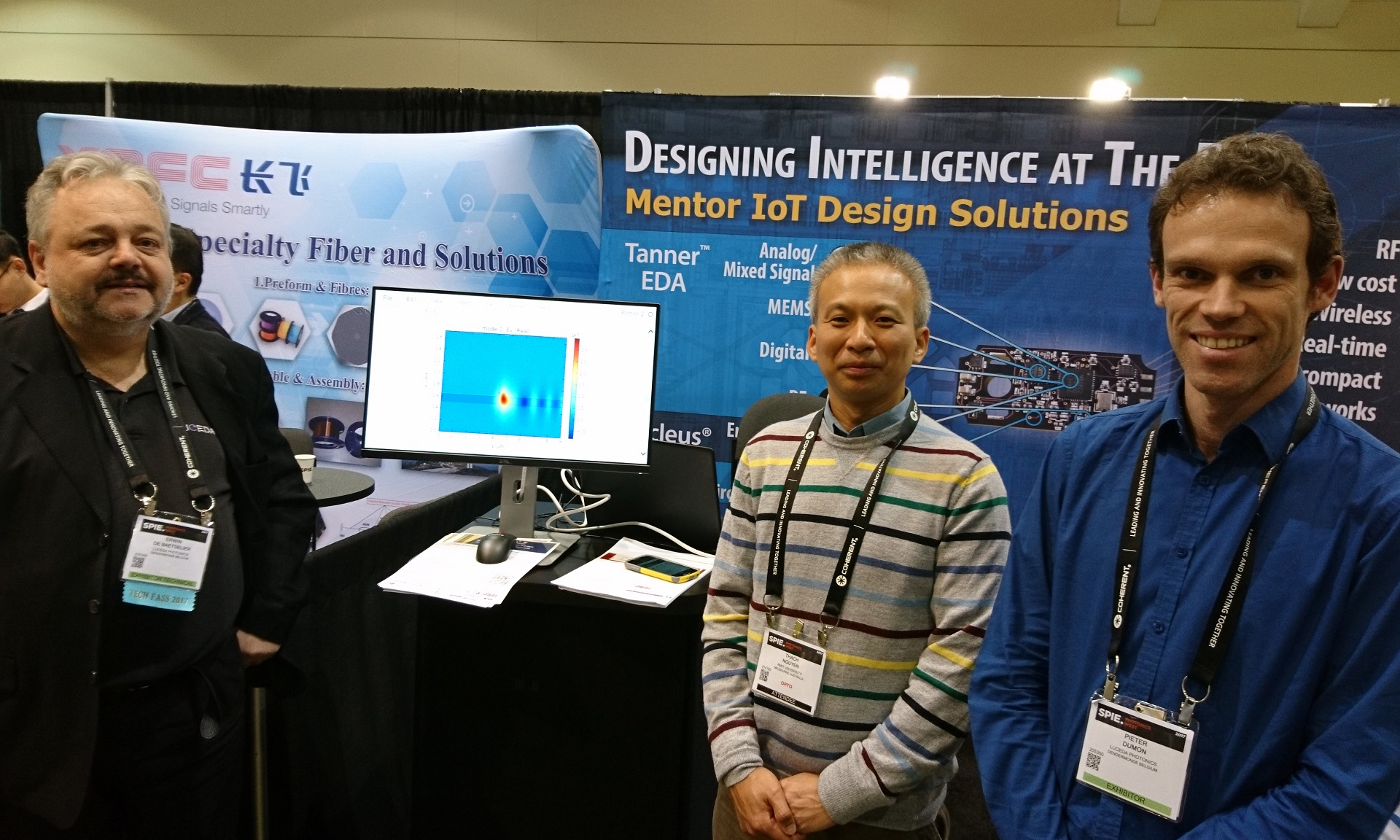 Senior Lecturer Dr Thach Nguyen (centre) with the Luceda team at the Photonics West conference in San Francisco where REME was launched.