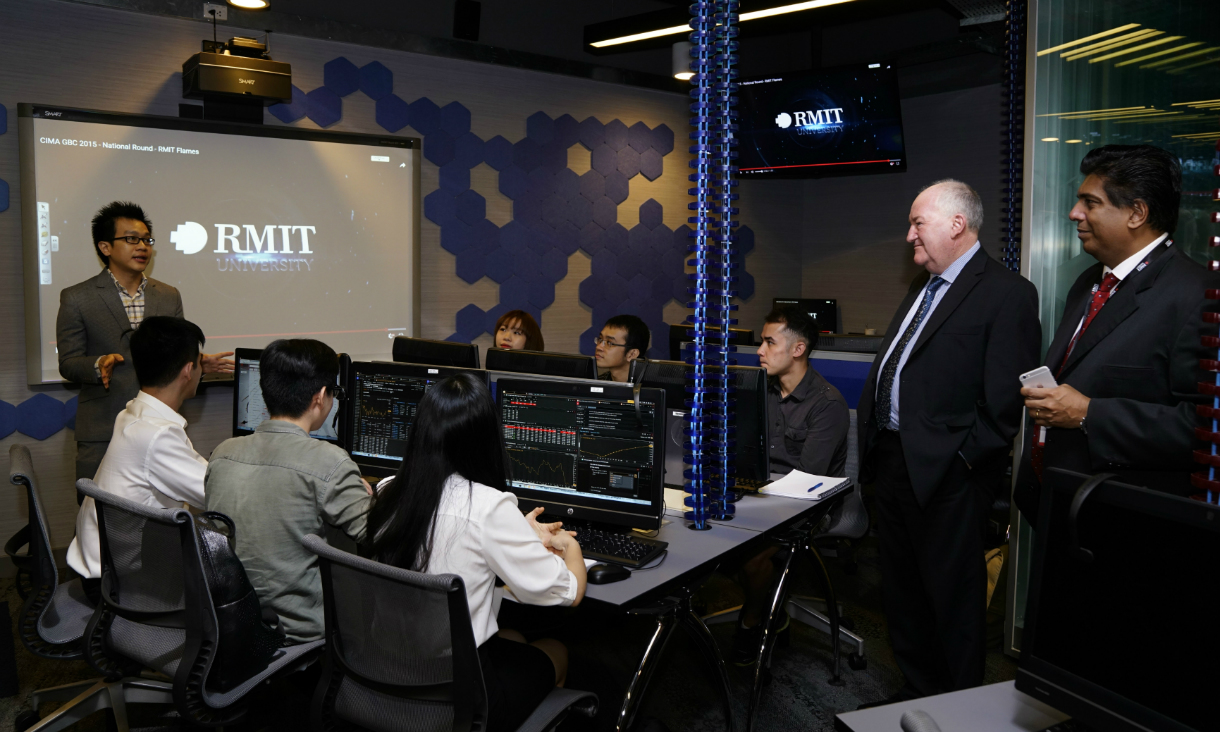 Steven Herbert, Victoria's Minister for Training and Skills, talks with students and staff at Saigon South campus.