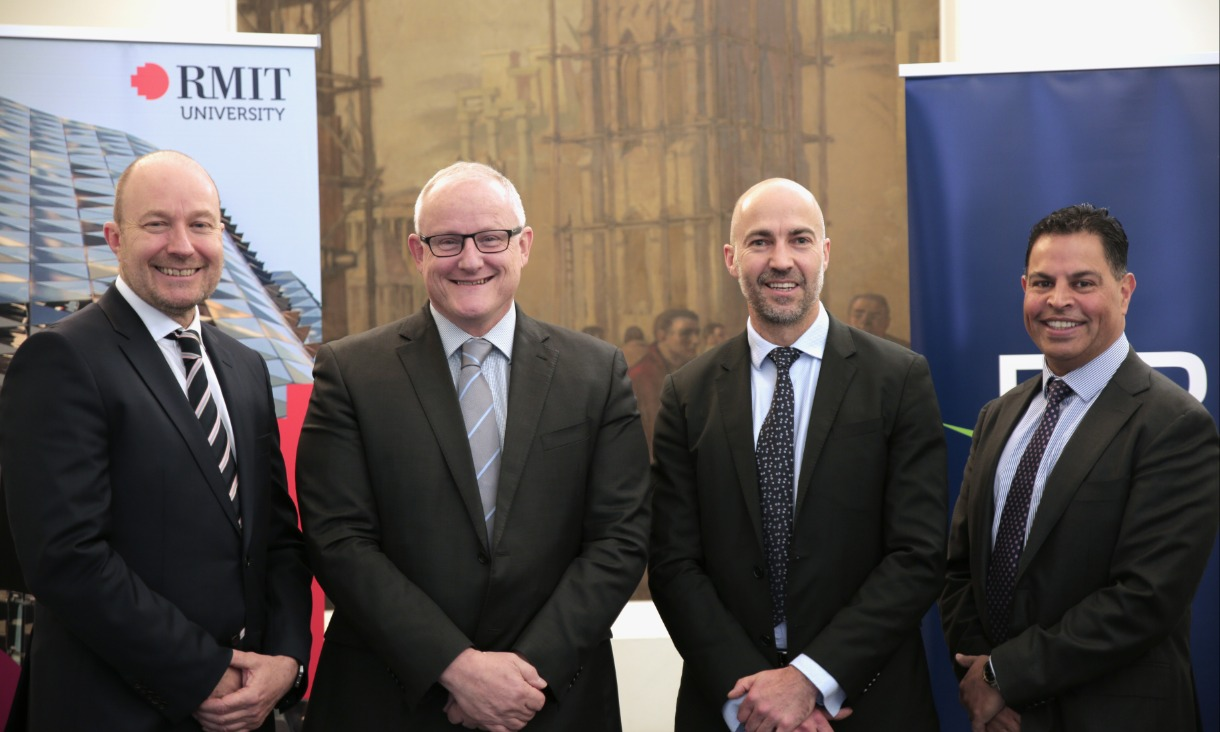 Head of Delivery, DB Results, Philip Hartley, RMIT University Deputy Vice-Chancellor Research and Innovation and Vice-President, Professor Calum Drummond, RMIT Blockchain Innovation Hub Director, Professor Jason Potts and CEO DB Results , Gavin Bunshaw after formalising the partnership.