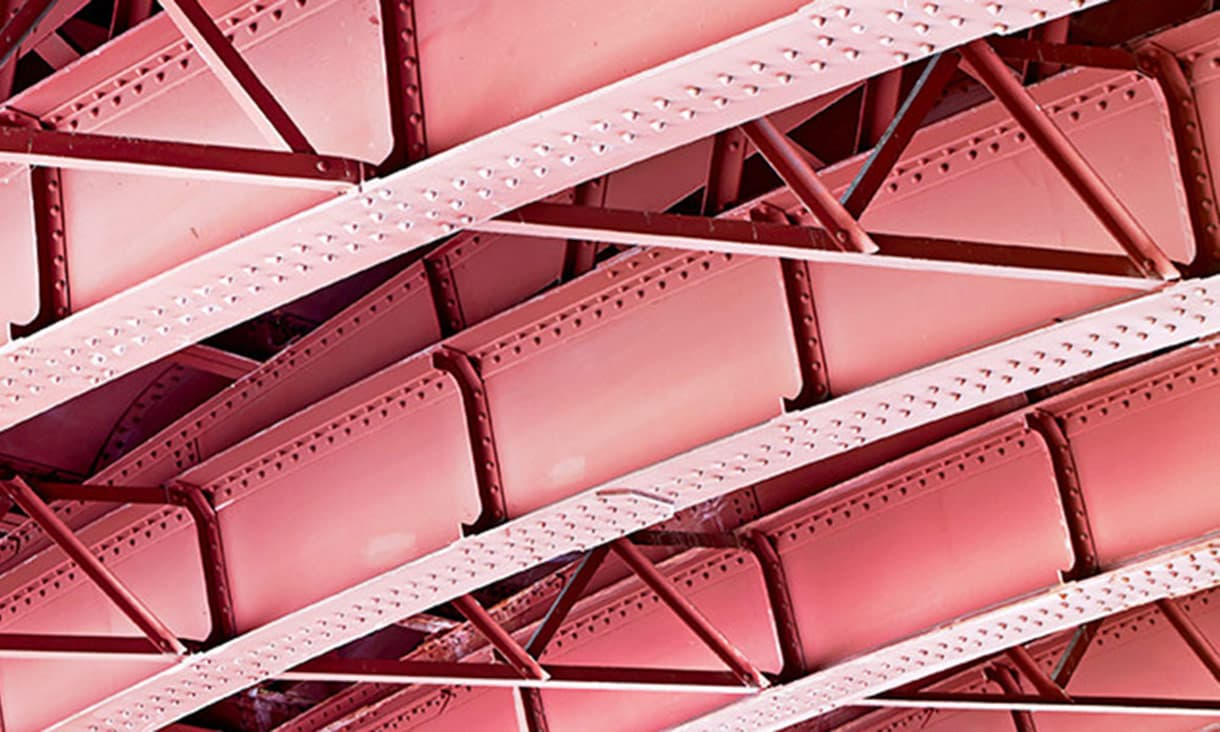 Rafters of red steel ceiling