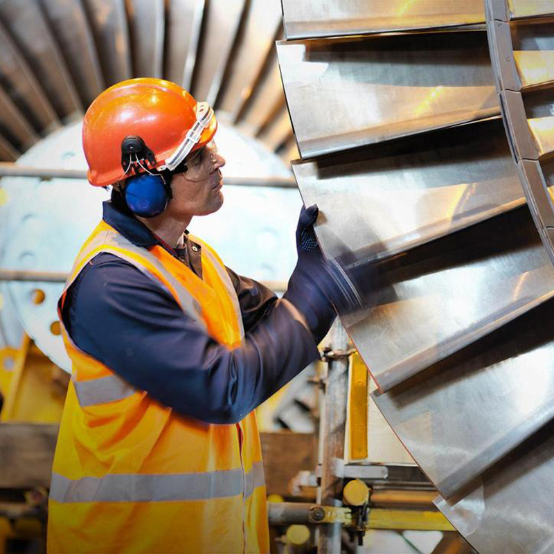 Man wearing hard hat with jet engine