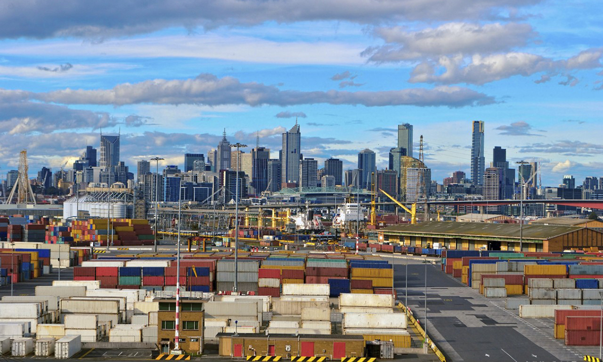 Melbourne city scape skyline with shipping containers in the foreground