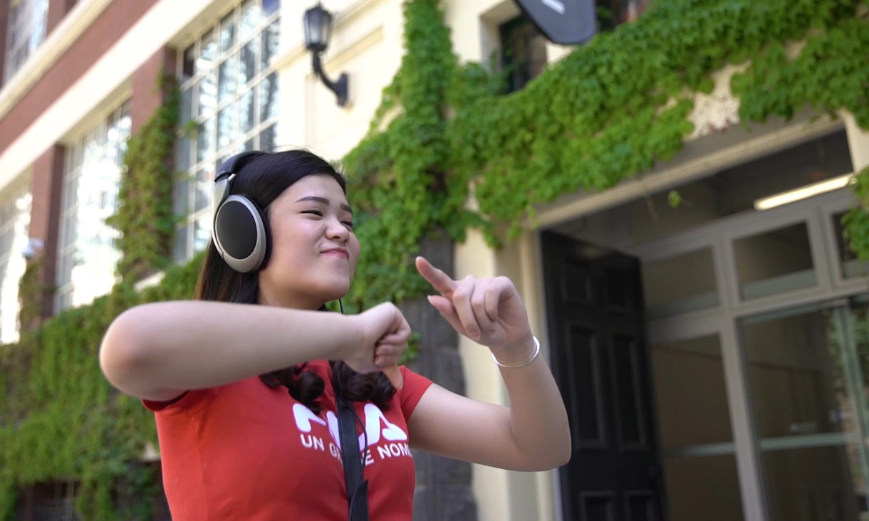 Student dancing with headphones on