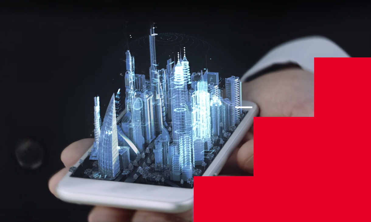 Hand holding phone with 3D hologram of a city projected