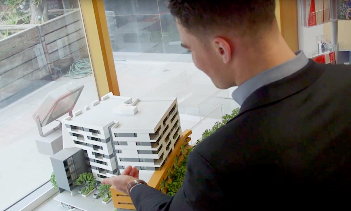 Student looks at model of building