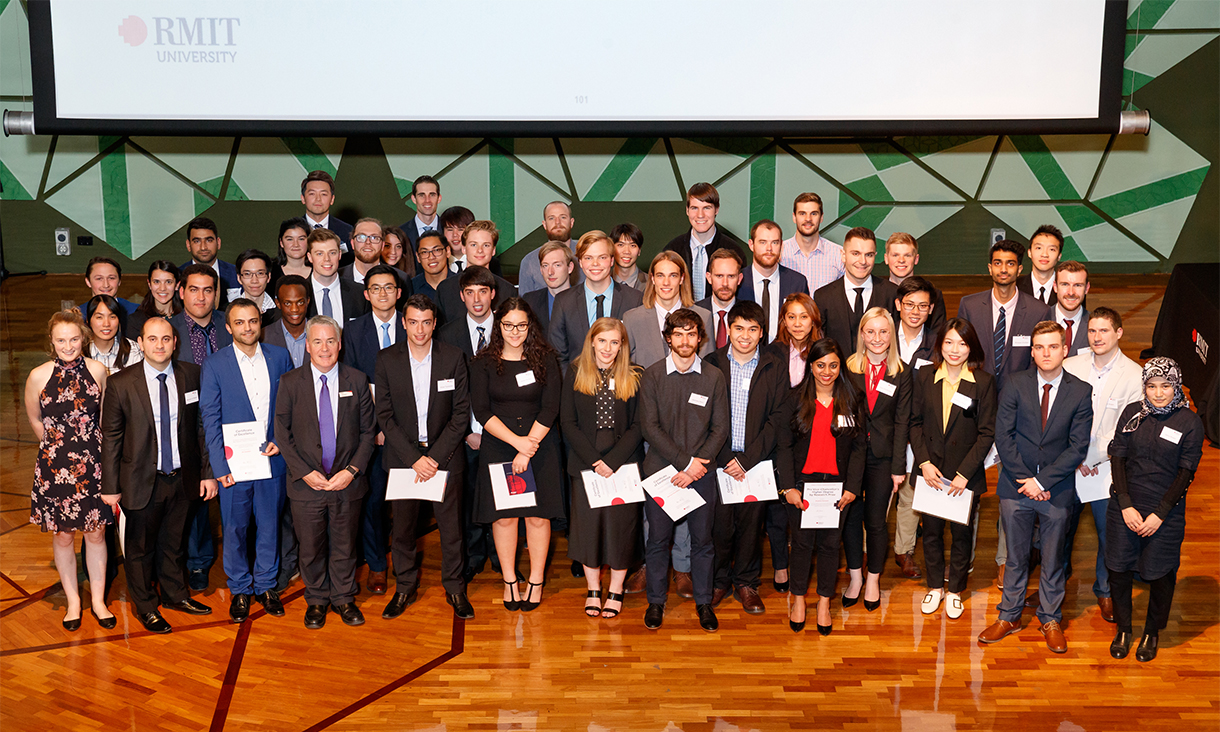The nearly 70 winners of the 2019 School of Engineering Prizes standing on stage holding their certificates.
