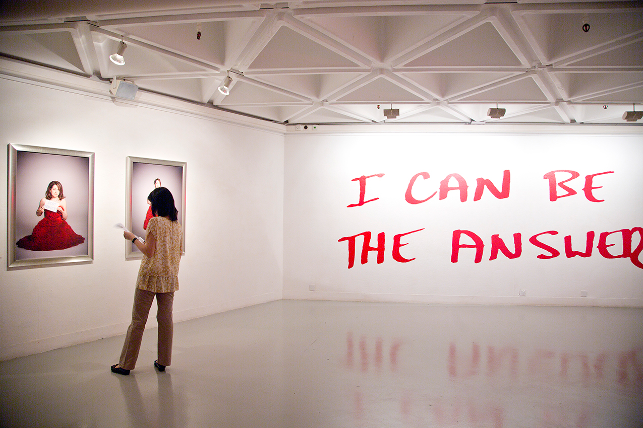 Image of a person looking at a painting in a gallery