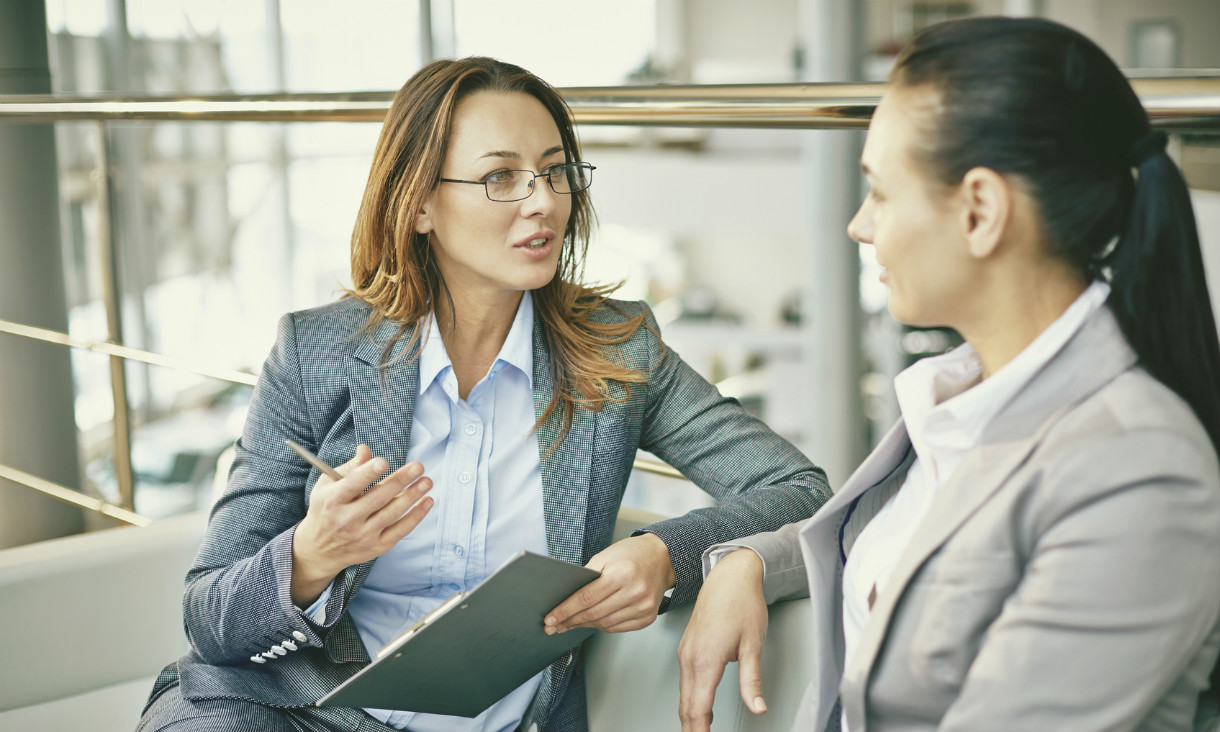 Two women discussing business