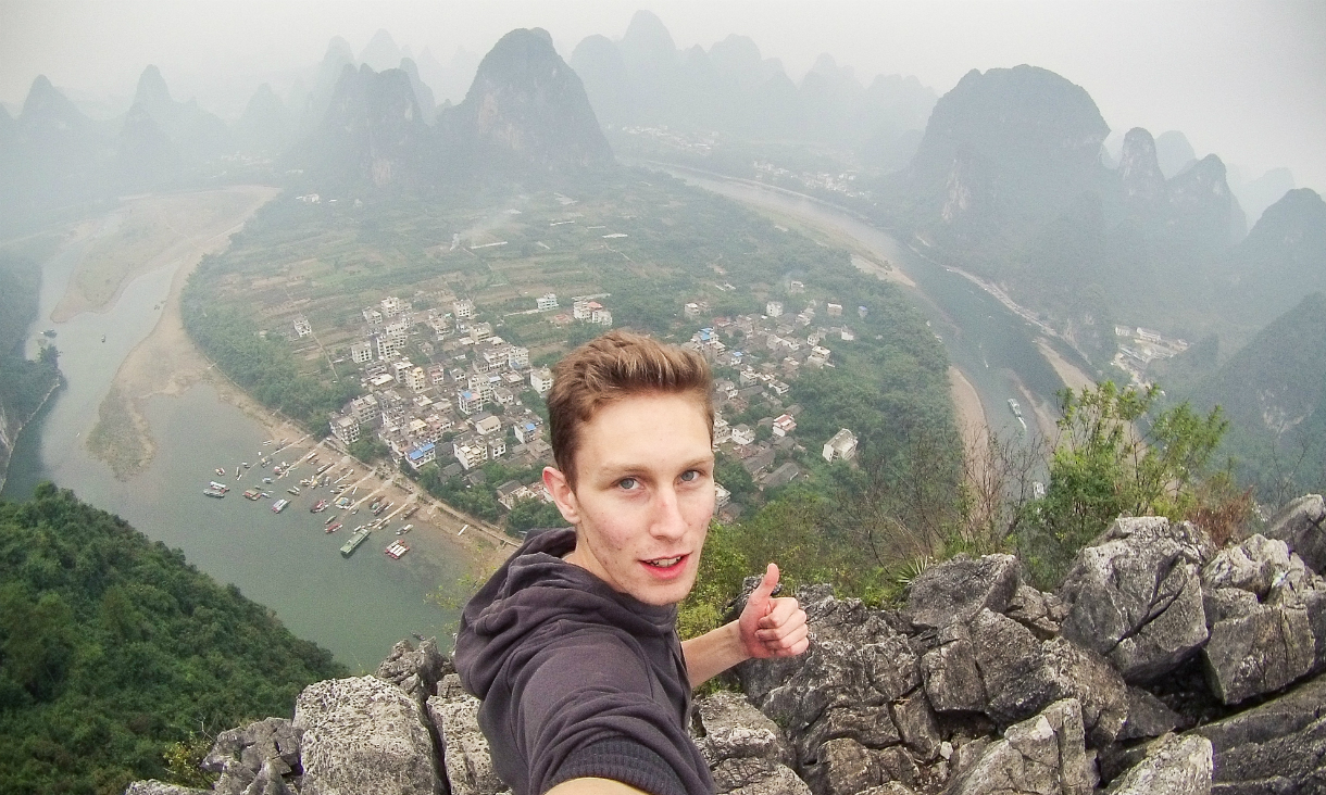 Student on top of Chinese mountain