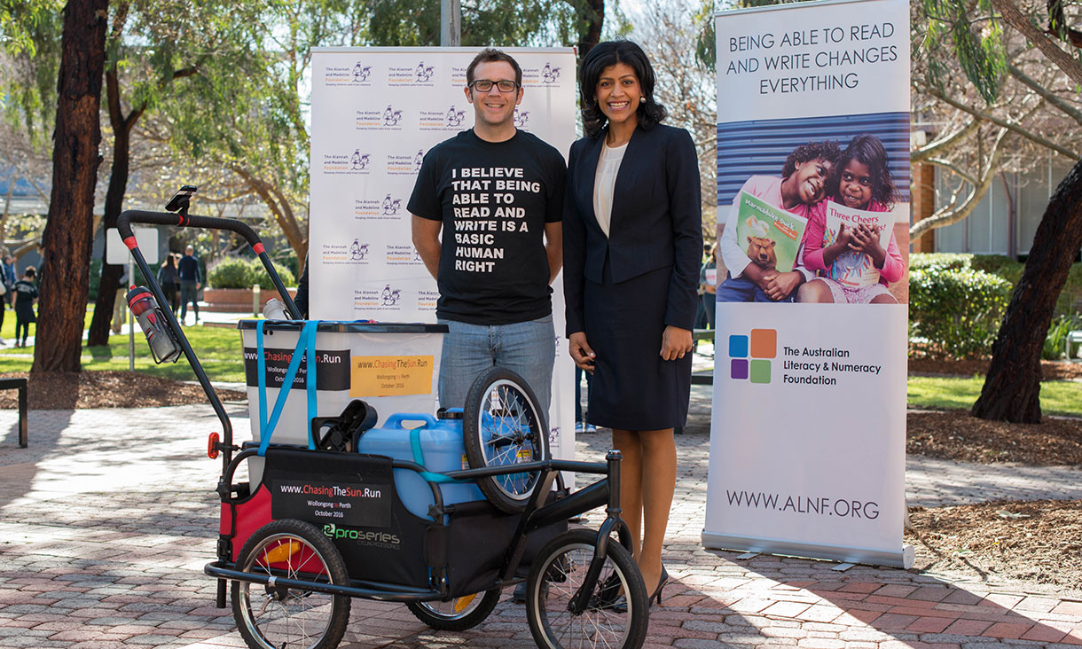 Marc Simpkins and Samantha Ratnam, Mayor of Moreland, standing next to an equipment buggy at RMIT Brunswick campus.