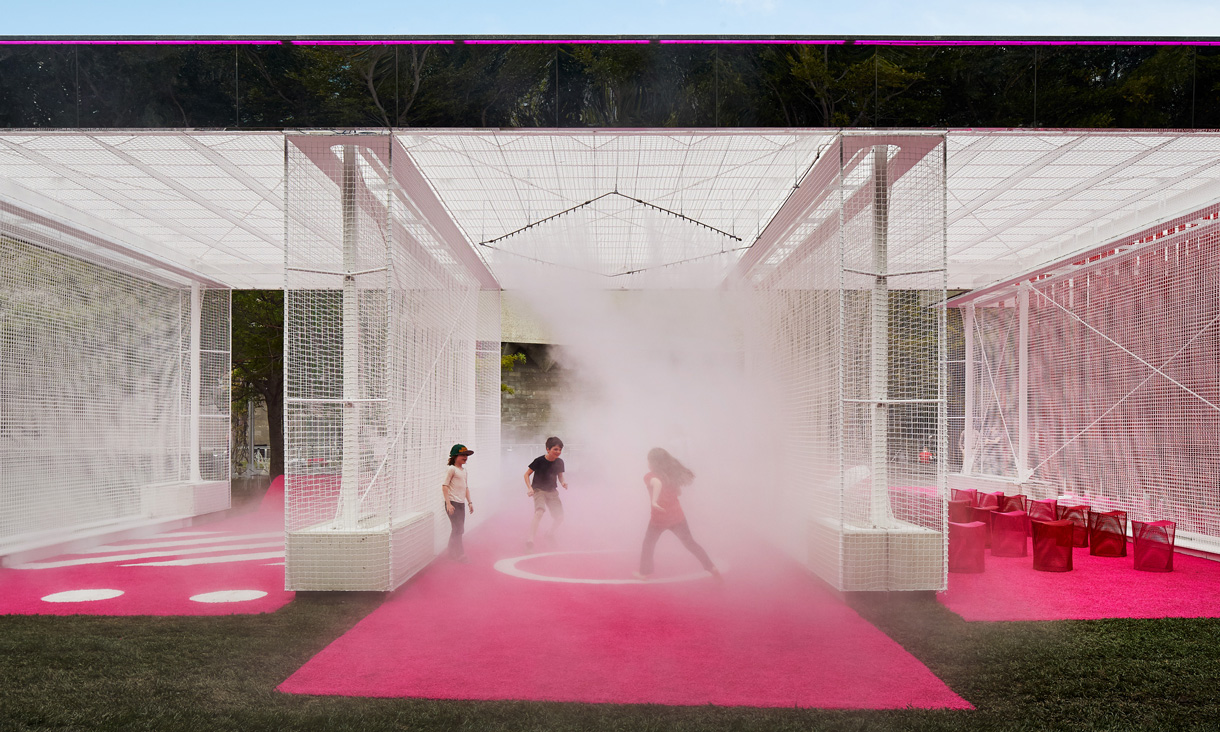 Children playing in the mist produced by the installation.