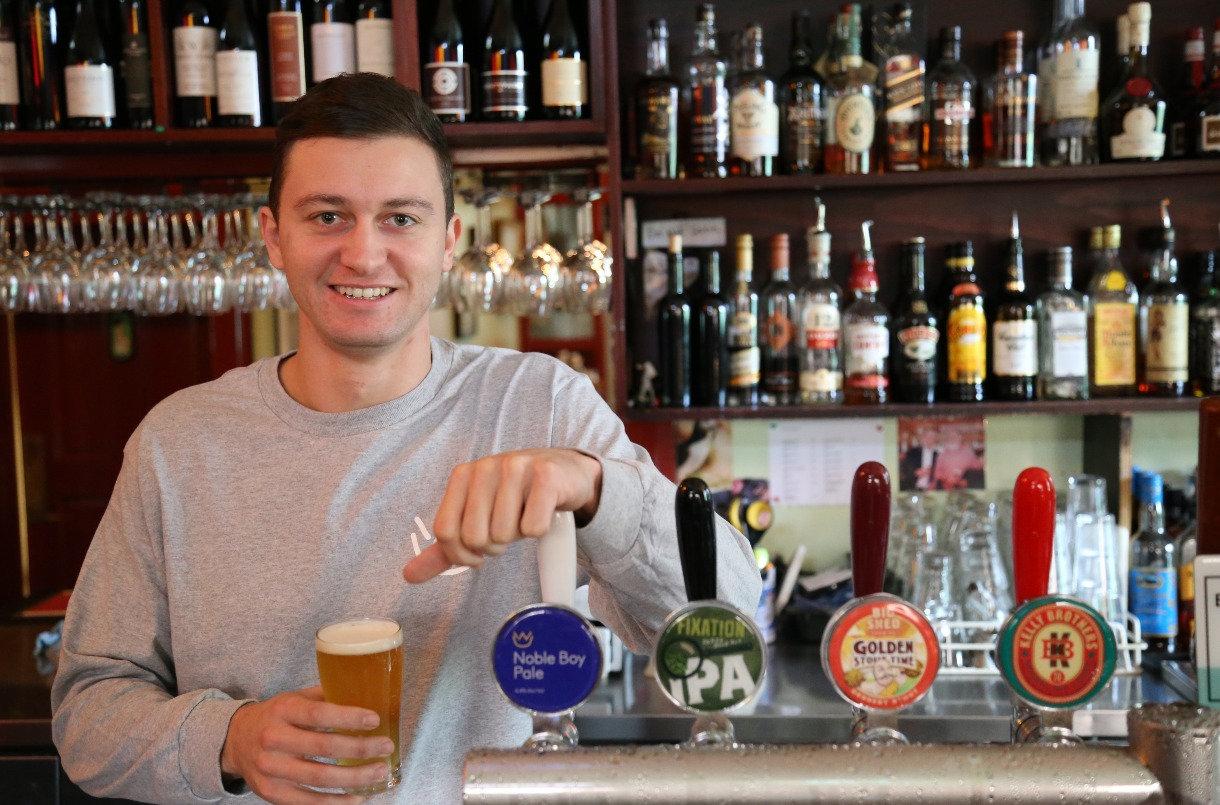 Director of Noble Boy brewery, Vedran Sabic, serves beer at one of his venues.