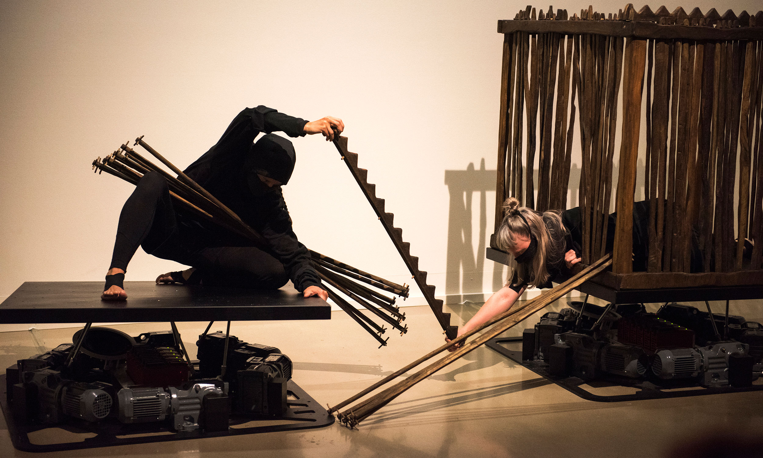 Melanie Lane and Amber McCartney perform 'Number of the Machine' with two  motion simulators. Photo: Vicki Jones.