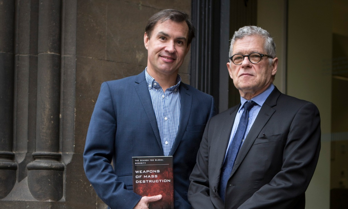 "Dr Aiden Warren and Professor Joseph Siracusa with their book, ""Weapons of Mass Destruction""."