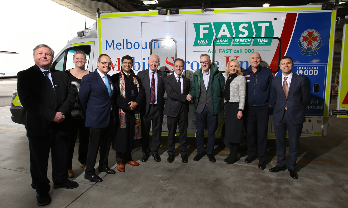 Bil, Fox and members of the 30-strong team with Australian Government Health Minister Greg Hunt MP and stroke survivor Barry Collins. The group is pictured in front of the Mobile Stroke Unit, which operates in Melbourne.