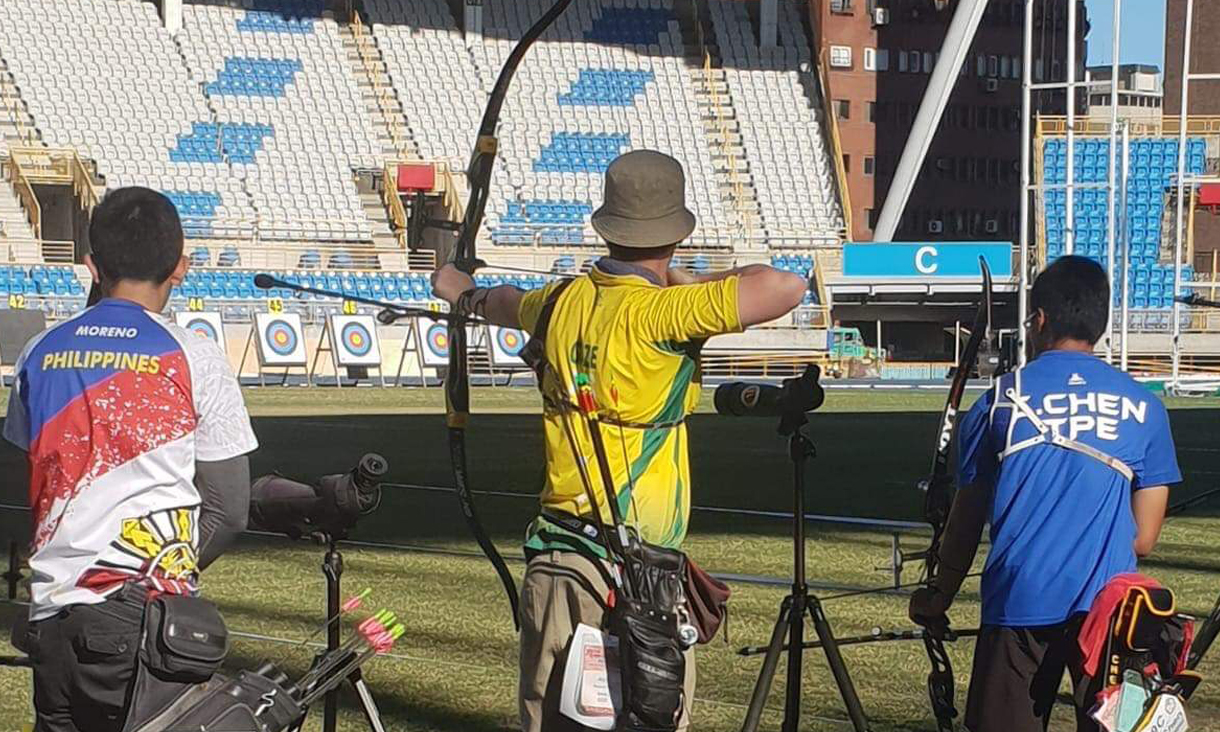 James Gaze competes in archery.