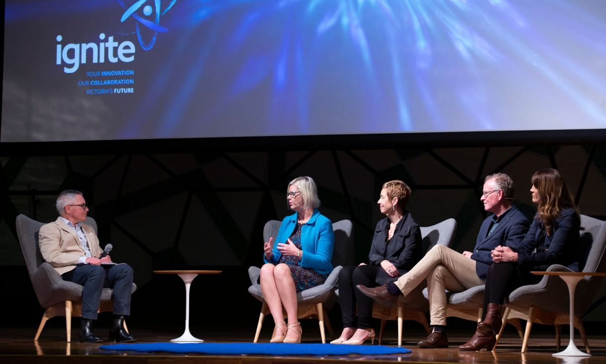 A panel of experts talking on stage at the ignite event