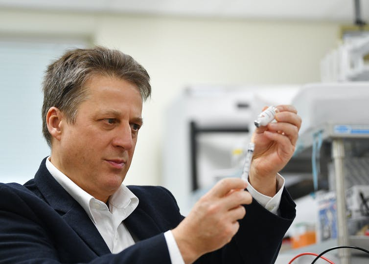 Professor Nikolai Petrovsky, of Vaxine and Flinders University, with the COVID-19 vaccine candidate. It was the first Australian-developed vaccine to enter phase 1 human trials, on July 1. David Maruiz/AAP