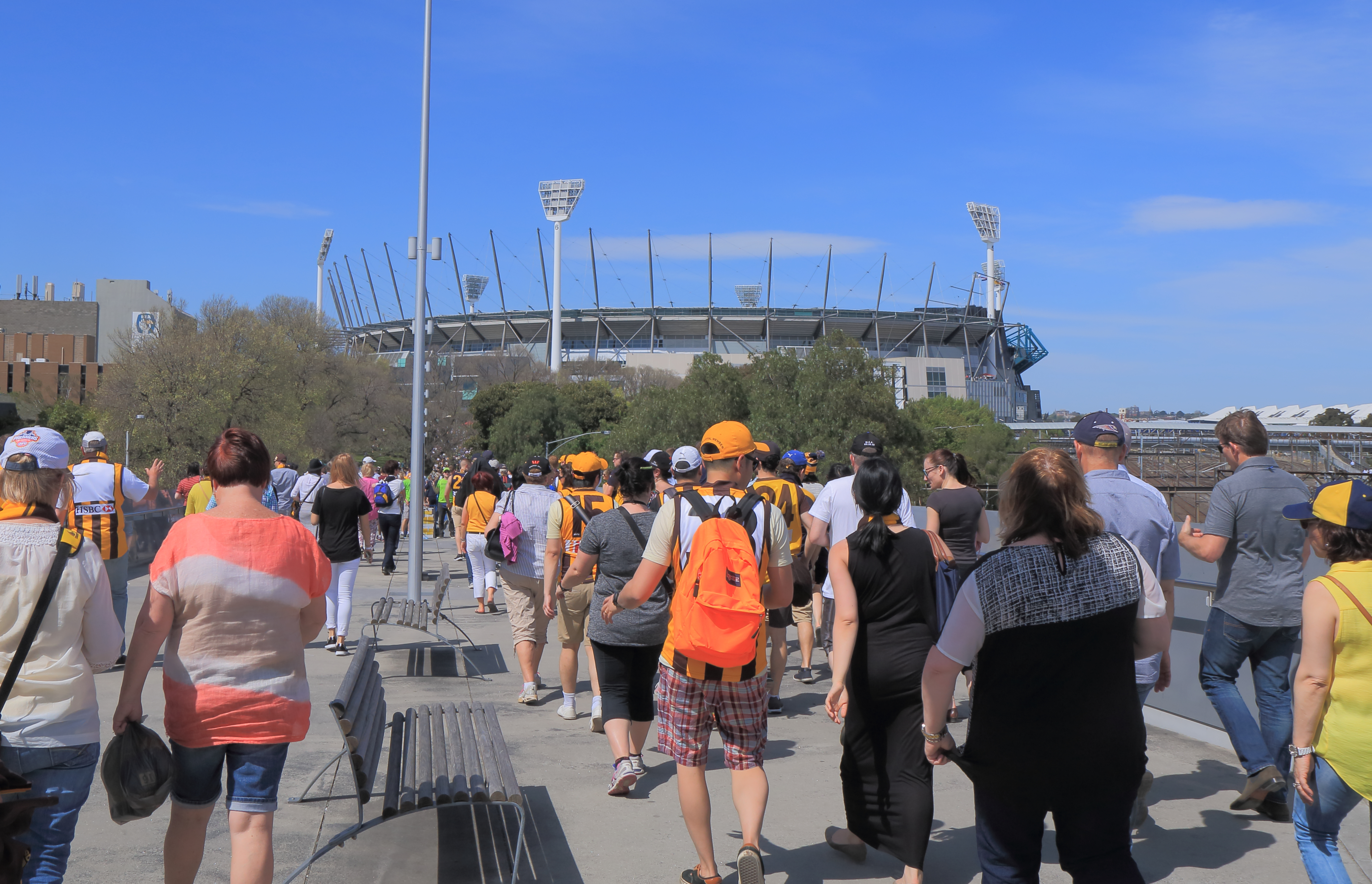 People visit the MCG for an AFL game.