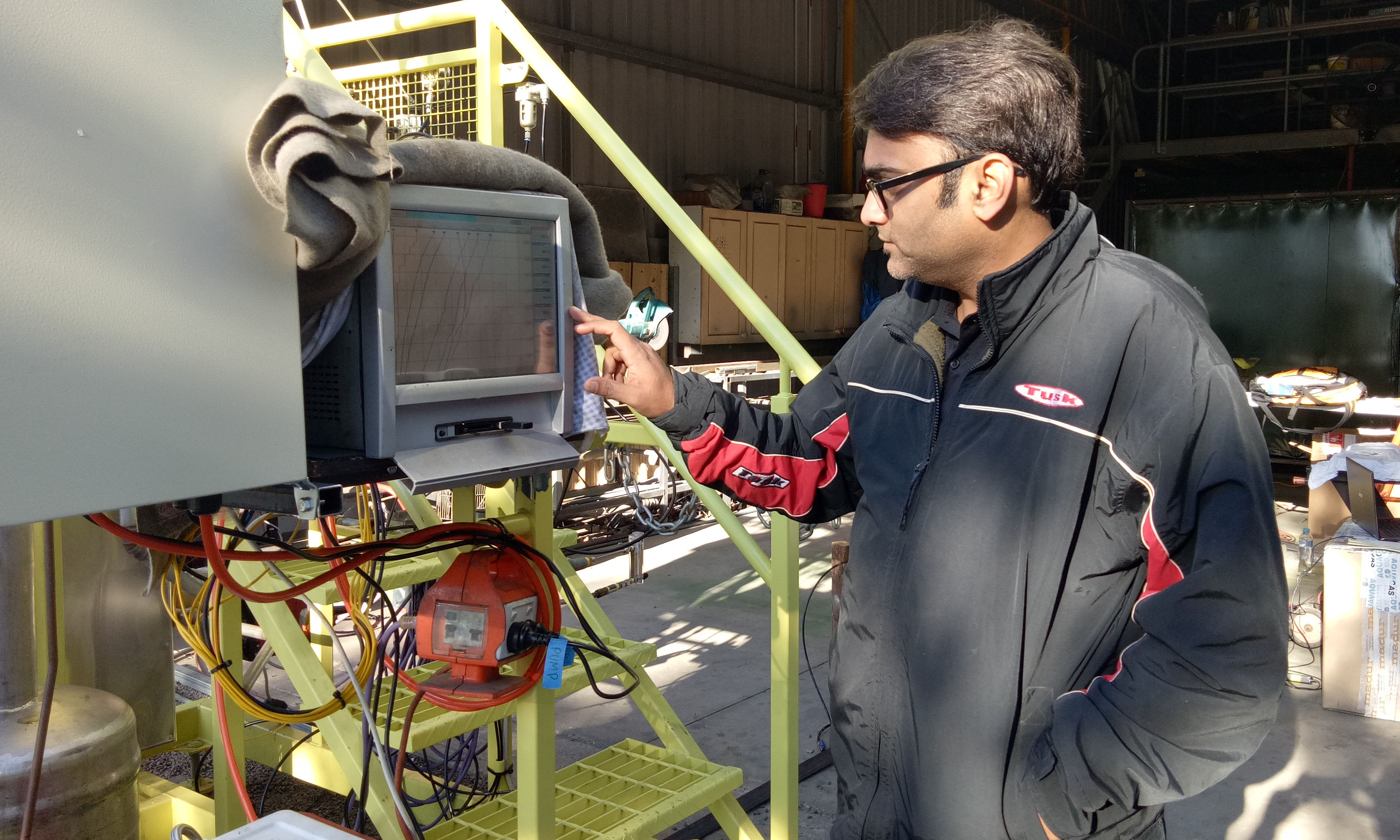 Lead researcher Associate Professor Kalpit Shah, with the novel reactor developed and patented by RMIT University.