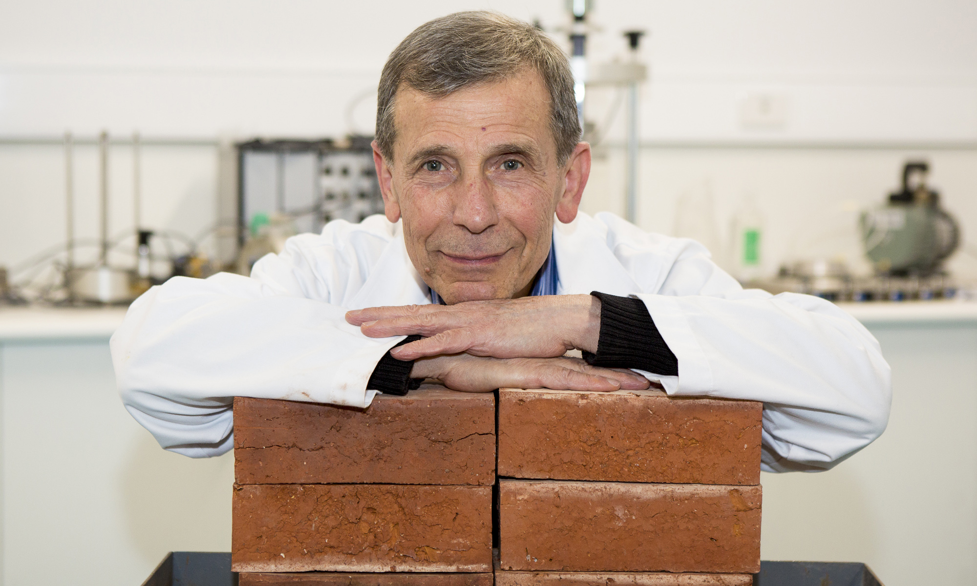 Associate Professor Abbas Mohajerani with bricks made with cigarette butts.