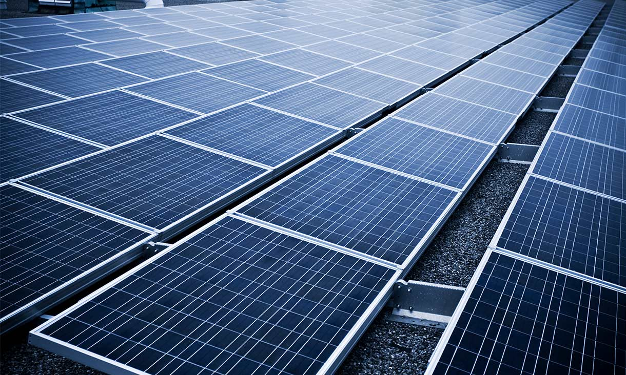 Solar panel on an industrial rooftop - stock photo