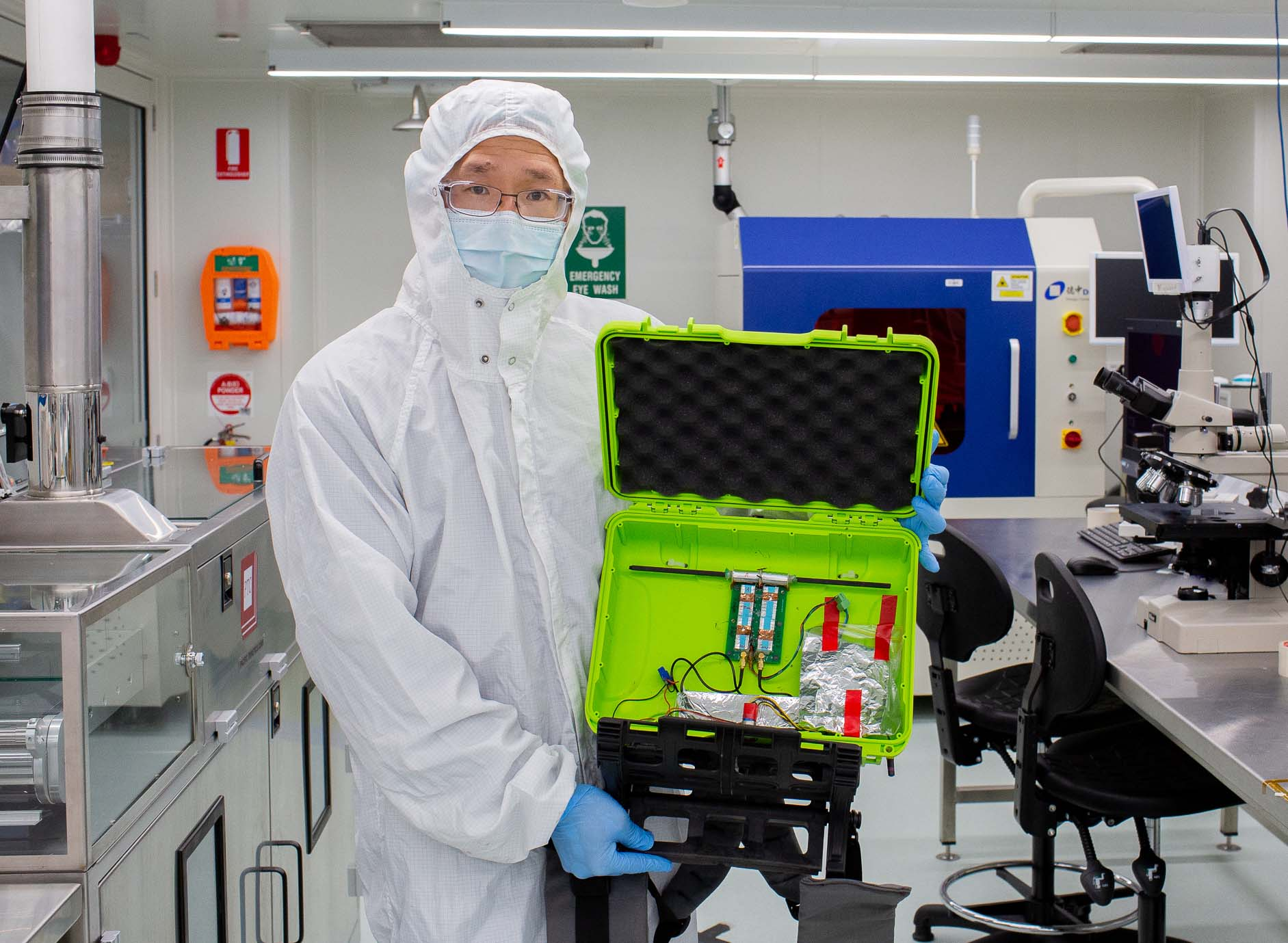 Lab technician holds MAPrad prototype in the Micro Nano Research Facility clean rooms at RMIT.