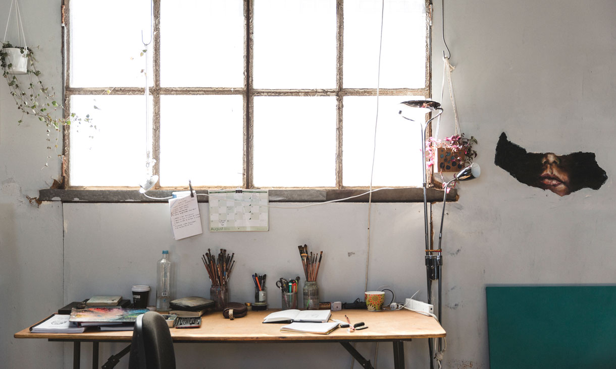 Julian Clavijo's studio desk under a large window.