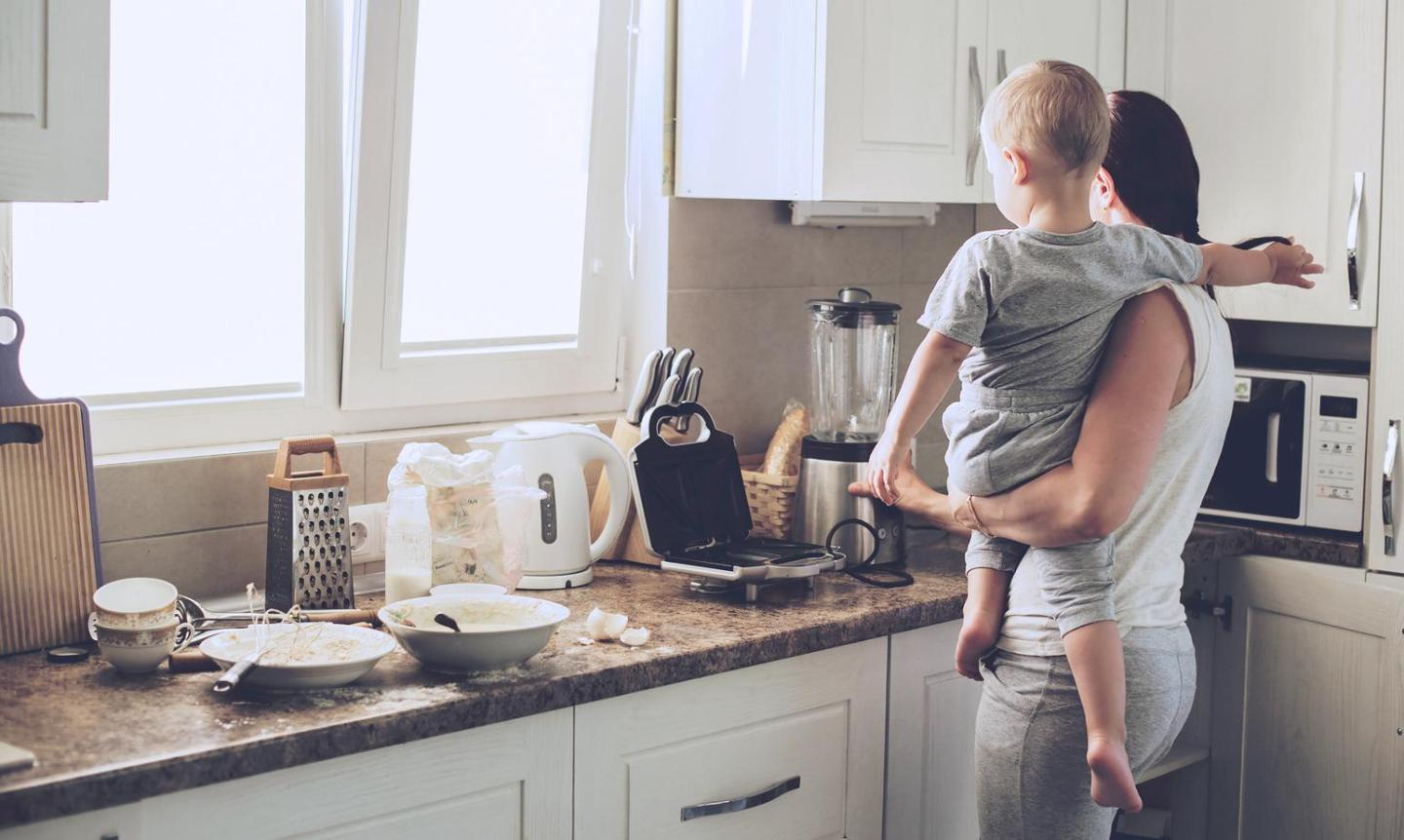 A mother with her child in the kitchen