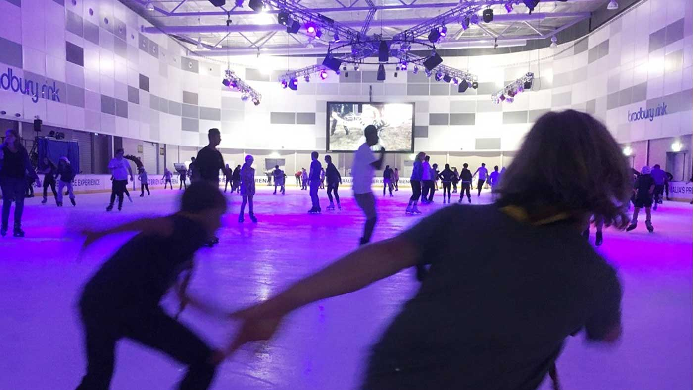 Students ice-skating at a previous night out