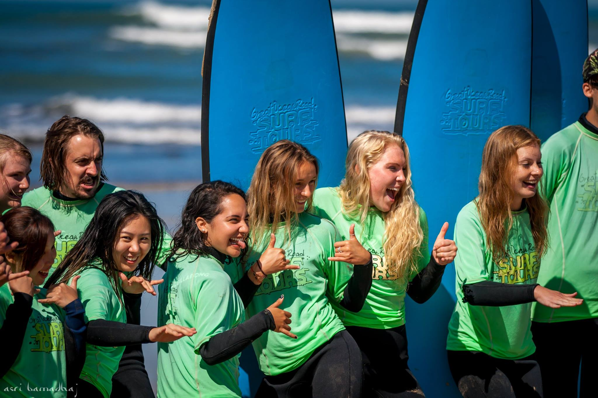 Students learning to surf at a previous trip
