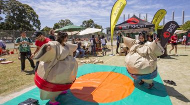 Two students in sumo suits at a previous Welcome Day. Join us for orientation 2018!