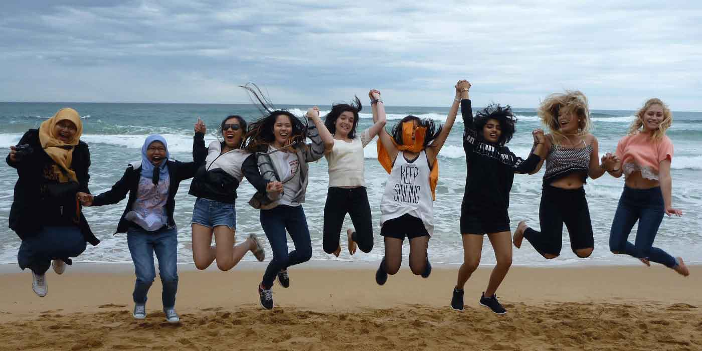 International students visit an Australian surf beach
