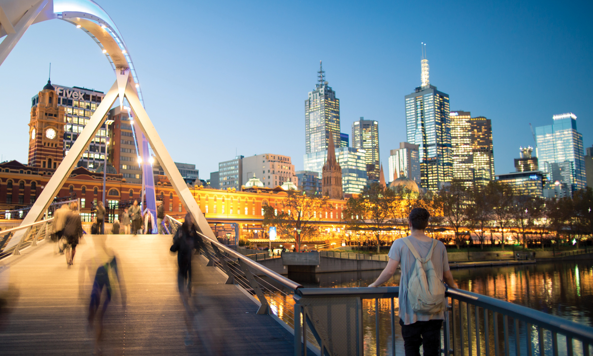 Student looking at Melbourne skyline at night