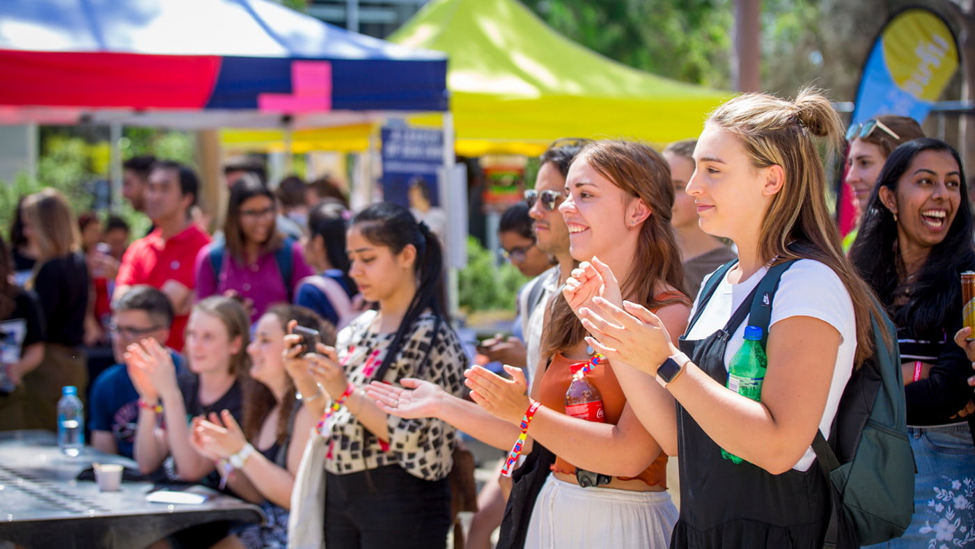 Students applauding at welcome day.