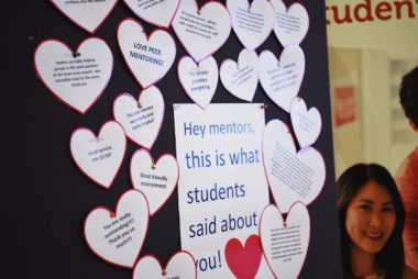 A board full of heart-shaped notes from students to their mentors.